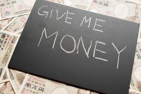 destitution: Give me money on the blackboard Stock Photo
