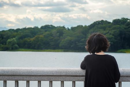 kinky: Asian woman looking at sky and lake