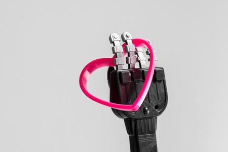 Robot holding pink heart