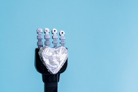 in low spirits: Robot holding cold heart Stock Photo