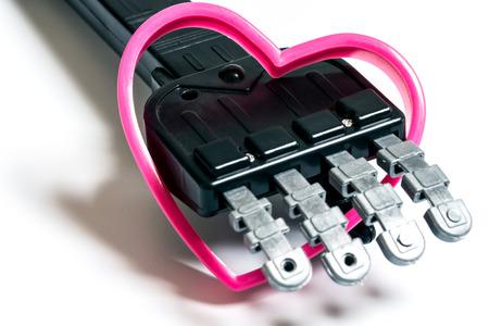 Robot hand holding pink heart