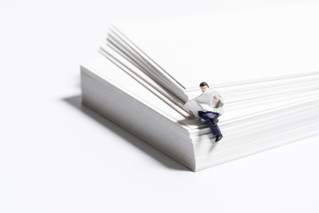 Businessman reading paper on the white paper