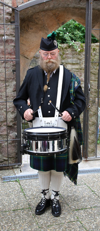 sporran: Scotsman with long beard, drum and kilt