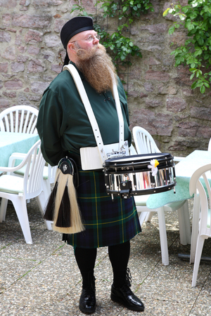 scot: Scotsman with long beard, drum and kilt