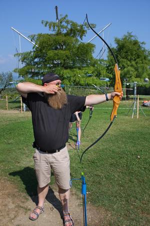 sporran: man with longbeard play archery Stock Photo