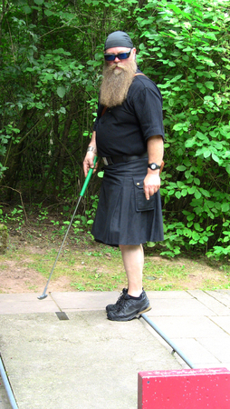 scot: man with longbeard in kilt playing golg Stock Photo