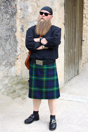 man with long bear in kilt