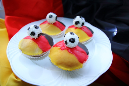 cake factory: Cupcakes, muffins in black, red, gold style with soccer ball Stock Photo