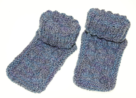 snugly: knitted Young baby socks Stock Photo