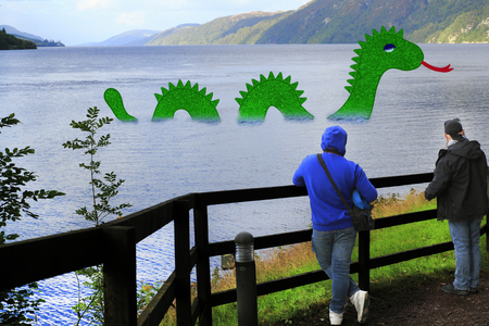 The monster of Loch Ness in Highlands of Scotland with August presents itself to the tourist Stock Photo