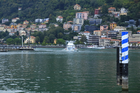 Look at Como, landing stage, harbor with bench promenade in Lake Como in Italy