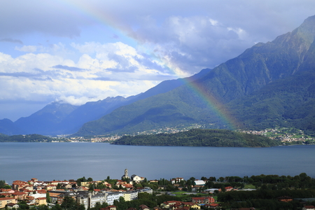 Look over Gravedona to Colico at Lake Como with a colored rainbow in the sunshine