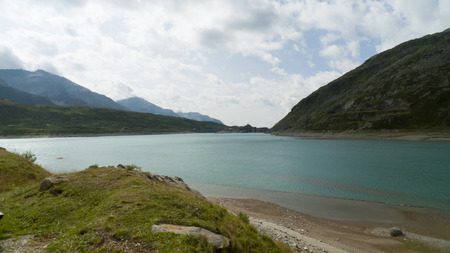Spluge pass with the Monte Spluga reservoir and surrounding mountains at Summer Lake Montespluga, Splugen Pass, Reservoir, Cardinello 免版税图像