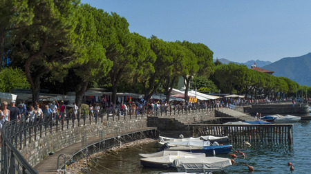 Promenade of Lenno, on the shore Lake Como, in Italy with market