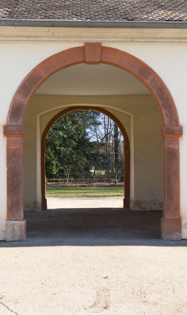 Old archway, passageway in a public outbuilding Stock Photo
