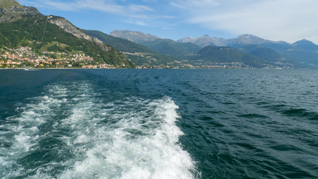 Look out on Musso, from Lake Como, from the boat, with waves