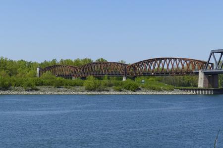 Old steel framework bridge over the Rhine to France