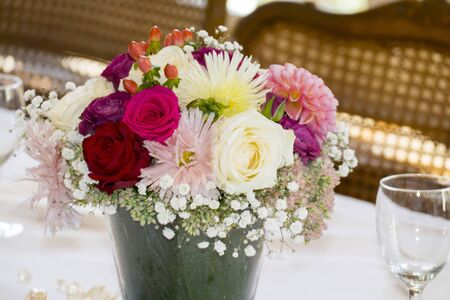 Bouquet of flowers festively arranged with roses and meadow flowers