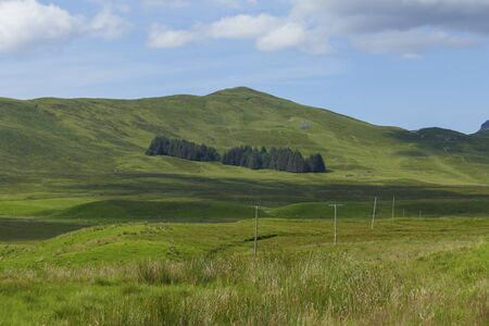Meadows, fields and hills, near Ledmore, in the Highlands of Scotland