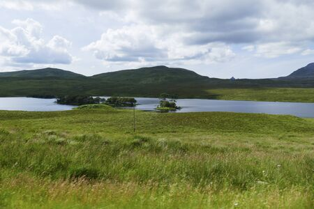 Loch Awe with small island in the Highlands of Scotland