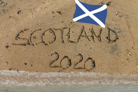 Scotland 2020 written in sand with Scottish flag, symbol for referendum Brexit