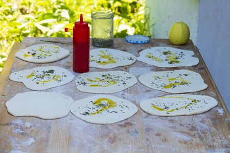 Bread flatbread with olive oil and herbs baked in a wood-burning oven