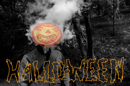 Man with smoking pumpkin head and the text Halloween 免版税图像