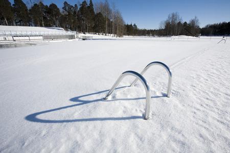 handrails: Swimming pool hand-rails at winter, Finland Stock Photo