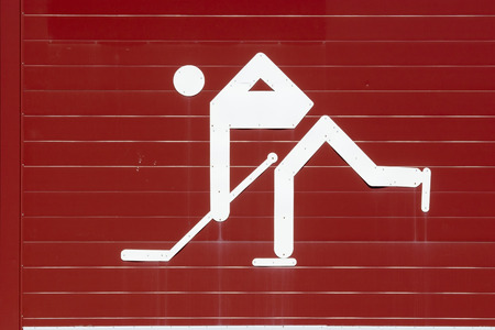 wintersport: white ice hockey player symbol on red wall