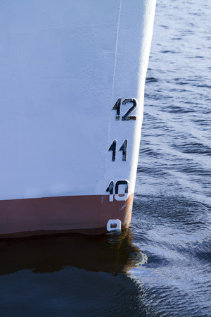 depth gauge: ships bow showing the plimsoll depth gauge