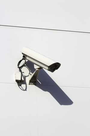 vandalize: Surveillance camera on building exterior
