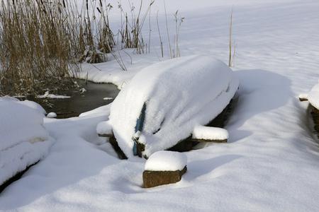 wintery snowy: small boat in snow, Finland