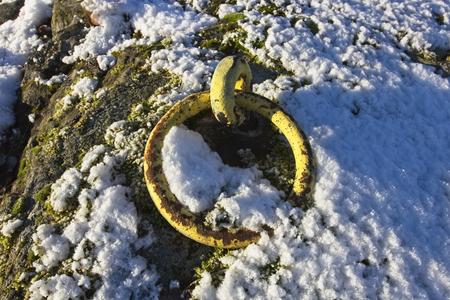 old yellow mooring ring