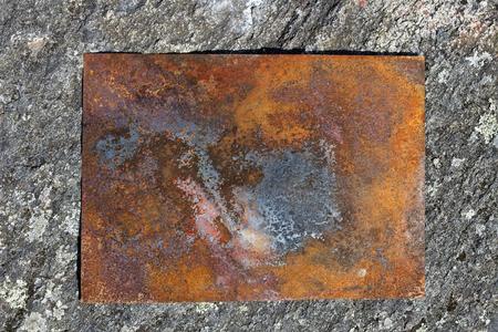 rusty metal plate on ground