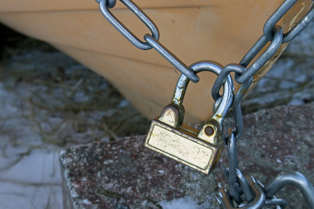 padlock and chains on boat outdoors
