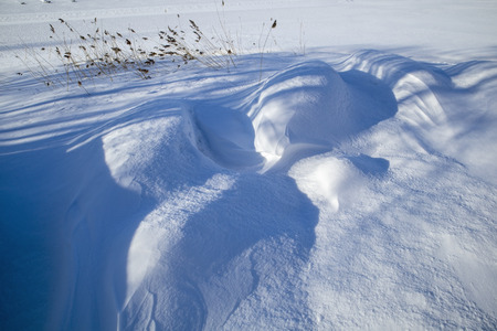 row boats buried in snow, Finland Stock Photo