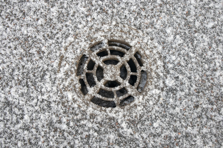 circular drain cover with snowflakes, Finland Stock Photo - 118682008