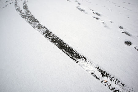 Car tyre tracks in snow Stock Photo