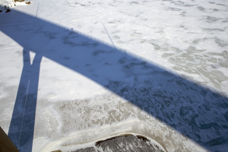 bridge shadow on frozen lake, Finland Stock Photo
