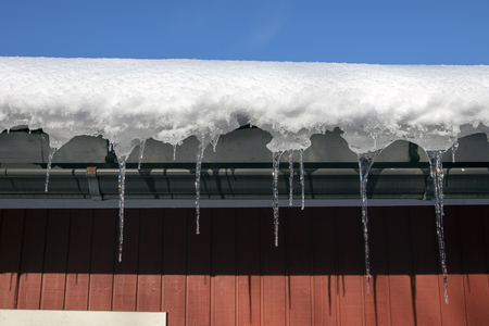 Icicles hanging from house eaves, Finland