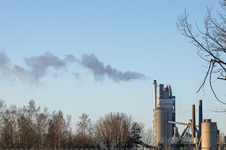 industrial smokestack at winter, Finland
