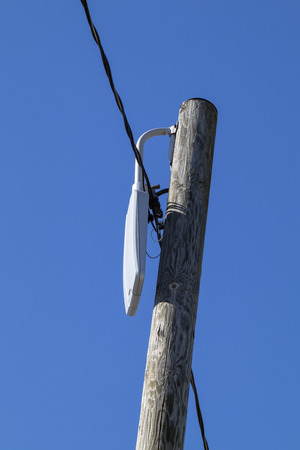 damaged streetlamp against blue sky