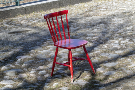 red wooden chair outdoors, Finland