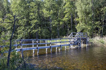 narrow old wooden bridge in Malonsaari, Imatra Finland 版權商用圖片