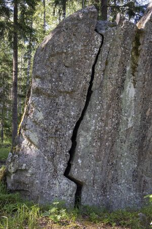 cracked boulder in the forest, Imatra Finland Stock Photo