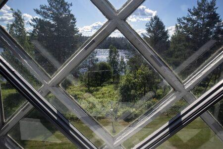 summer scenery behind old window, Finland