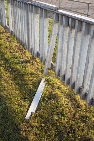 broken white wooden fence