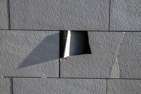 broken tile on a wall