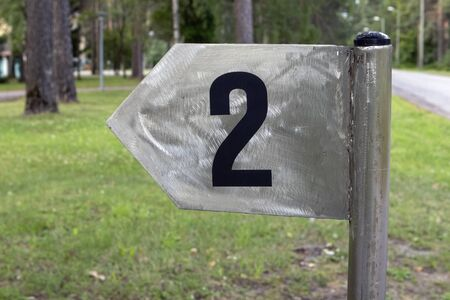 Number two sign post outdoors