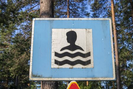 old swimming place traffic sign, Finland Imagens - 131843720
